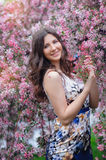 Happy woman in pink flowers in spring wild apple Stock Photos