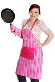 Happy woman in pink kitchen apron. Stock Photography