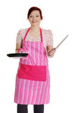 Happy woman in pink kitchen apron. Royalty Free Stock Images