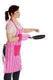 Happy woman in pink kitchen apron. Stock Image