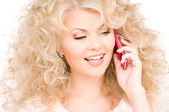 Happy woman with pink phone Stock Photography
