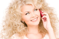 Happy woman with pink phone Royalty Free Stock Photo