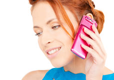 Happy woman with pink phone Stock Images
