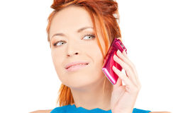 Happy woman with pink phone Royalty Free Stock Photography