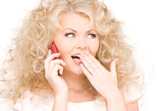 Happy woman with pink phone Royalty Free Stock Image