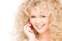 Happy woman with pink phone Stock Image