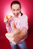 Happy woman with pizza showing thumbs up Stock Photography