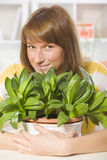 Happy woman with plants Stock Images