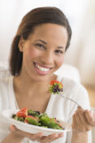 Happy Woman With Plate Of Fresh Salad At Home Royalty Free Stock Photos