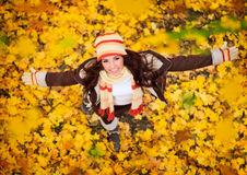 Happy woman playing in autumn stock images