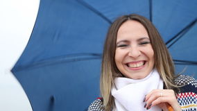 Happy woman playing with blue umbrella outdoor stock video