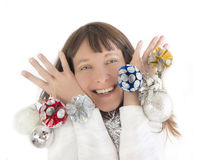 Happy woman playing with Christmas decorations. Happy woman smiling and playing with Christmas decorations Royalty Free Stock Images