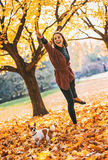 Happy woman playing with dogs outdoors in autumn Royalty Free Stock Photo