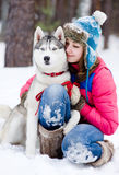 Happy woman playing with husky outdoors Stock Image