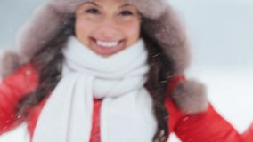 Happy woman playing with snow outdoors in winter stock video footage