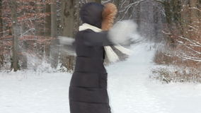 Happy Woman playing with snow stock video