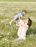 Happy woman playing with son. Happy woman playing with her son Stock Photography
