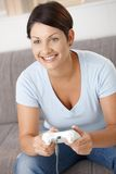 Happy woman playing video game Royalty Free Stock Photo