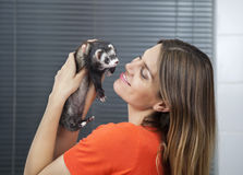 Happy Woman Playing With Weasel In Veterinary Stock Photography
