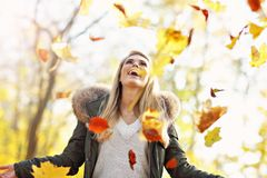 Free Happy Woman Playing With Autumn Leaves Outdoors Stock Photo - 104280290