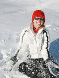 Happy woman plays with snow. Happy smiling woman plays with snow Royalty Free Stock Photography