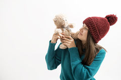 Happy woman plays with a teddy bear isolated on white Royalty Free Stock Images