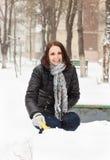 Happy woman pleasure to snow Stock Images