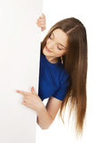 Happy woman pointing on blank board. Royalty Free Stock Photography