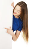 Happy woman pointing on blank board. Royalty Free Stock Photo