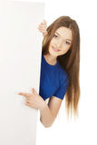 Happy woman pointing on blank board. Stock Photography