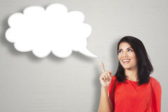 Happy woman pointing at cloud bubble Royalty Free Stock Images