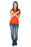 Happy woman pointing in different directions standing in full length Stock Image