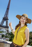 Happy woman pointing on Eiffel tower in Paris Stock Photos