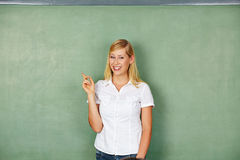 Happy woman pointing on empty Stock Photo