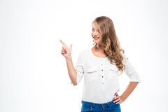 Happy woman pointing finger away Royalty Free Stock Photos