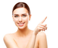 Happy Woman Pointing by Finger, Smiling Girl Beauty Face Makeup. Beautiful Model white isolated stock photos