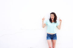 Happy woman pointing fingers up and smiling Royalty Free Stock Photography