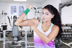 Happy woman pointing her bicep Stock Photography