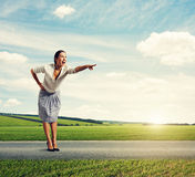 Happy woman pointing at something. Amazed happy woman pointing at something Stock Image
