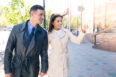 Happy woman pointing on something to her husband Stock Photography