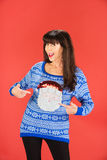 Happy woman pointing to her sweater Stock Image