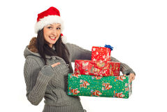 Happy woman pointing to her Xmas gifts Royalty Free Stock Image