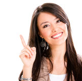 Woman pointing up Royalty Free Stock Photos