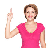 Happy woman pointing up with her finger Royalty Free Stock Photos