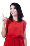 Happy woman pointing up - isolated Stock Image