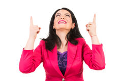 Happy woman pointing up Stock Photo