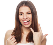 Happy woman poiting finger up at copyspace isolated on a  white Royalty Free Stock Photography