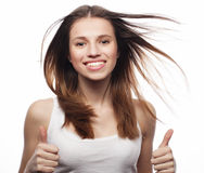 Happy woman poiting finger up at copyspace isolated on a  white Stock Image