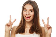 Happy woman poiting finger up at copyspace isolated on a  white Stock Photos