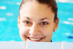 Happy woman in pool Royalty Free Stock Photos
